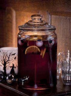 Skeleton Sangria 4 cups ice cubes Two bottles chilled dry red wine (Zinfandel, Merlot or Pinot Noir) 8 oz oz. pineapple nectar 8 oz. Cointreau 8 oz. sparkling water 2 oz. fresh lime juice 2 oranges,...