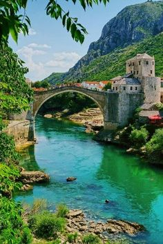 Mostor Basnia Bridge.... The Bridge on the River Neretva  The Stari Most or Old Bridge is the key image of Mostar in Bosnia & Herzegovina. The 30 metre humpbacked bridge was first built in 1566-67 and was of unprecedented dimensions: at it's time it was the widest man-made arch.