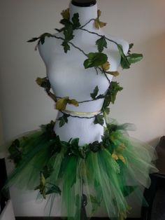 Adult Poison Ivy costume.  Short, spiky, and sassy pieces of green tulle are accented with many vines.  A large vine accompanies the tutu, and can be wrapped around the body to finish the look.