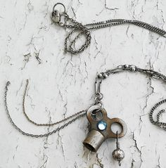 """Steampunk Antique Silver & Grey Tone Key """"Key To Nowhere"""" Hanging Silver Rose Curiosity Oddity Jewelry Necklace by DreamAddict on Etsy"""