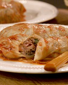 When Martha was growing up in Nutley, New Jersey, her grandmother often made a Polish version of stuffed cabbage leaves called golabki. The filling was a simple one -- rice and meat with onions, garlic, celery, cloves, and green apple -- but the dish was as tasty as it was comforting. Served with a hot tomato sauce and creamy sour cream, it's a perfect meal for the winter season.    Cabbage is often dismissed as too odorous and not particularly tasty. But these problems result from overcooking