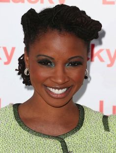 Natural hairstyles for women - Dreadlocks in an updo.  Updos for medium hair.