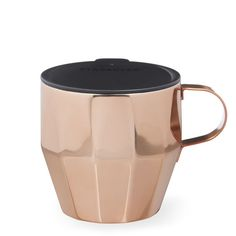 A stainless steel desktop-style coffee mug with a cool faceted design and copper shine.