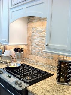 kitchen back splash - I like the square of something different above the stove, but probably something other than that.