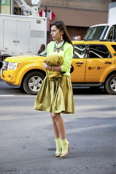 Stay one toned! This girl knows how to make bright yellow work from head to toe.