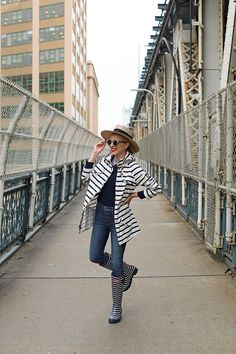 What to wear in the rain. Stripes for the win! Outfit details: Joules rain boots and a Barbour Jacket. #joules #rain #springoutfit