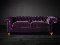 Plush purple velvet sofa, pretty.