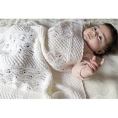 Baby blanket with delicate leaf and bobble panels, sure to become a treasured heirloom Knitting pattern by OGE Knitwear Designs | Knitting Patterns | LoveKnitting