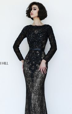 Have an awesome look in Sherri Hill 4340.This exquisite evening long gown features a full length sleeves that will make you stand in the crowd.The gown is embellished with lovely lace all over the bodice and an open back designed that added a sexy touch.