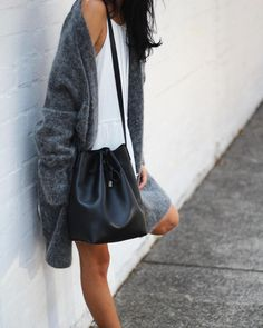 Oh my goodness. That sweater and that bad are perfect. Plus a little white dress! Too much!