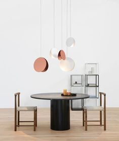 Lights made from copper discs. Suspension lighting is the perfect contemporary lighting option for every kind of house/apartment/hotel/restaurant/bar and to every corner of it. Bedrooms, bathrooms, living rooms and dining rooms should be enhanced with beautiful and modern chandeliers. See more home design ideas, here: http://www.pinterest.com/homedsgnideas/