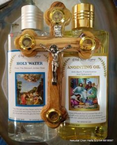 Holy-water-250-anointing-oil-250-ml-and-olive-wood-cross-from-Jerusalem-gift  Approximately ILS 76.77