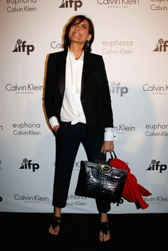 Carrying Roger Vivier's Diligence bag in black coco and wearing the Itaca sandals at the Calvin Klein party during the 64th Annual Cannes Film Festival