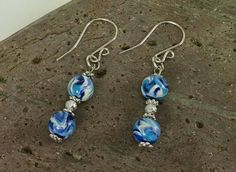 """Classy 2"""" dangle earrings with blue and white swirl 8mm beads created from polymer clay. Silver spacers and beads. Handcrafted sterling silver french hook style earrings.    ~ Handcrafted, one of a kind pieces    ~ Each item purchased is carefully packaged in a organza gift bag    ~ Payment accepted: credit and debit cards, Etsy gift cards, Paypal    ~ See more items at www.etsy.com/shop/CatsUniqueBeads    ~ See more earrings at…"""