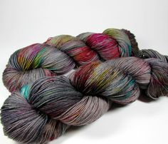Speckled Hand Dyed Sock Yarn, Fingering Weight, Superwash Merino Wool, Nylon, Variegated, Gray, Rainbow Colors, Slick, Ready to Ship by DyeIsCastYarns on Etsy https://www.etsy.com/listing/507037148/speckled-hand-dyed-sock-yarn-fingering