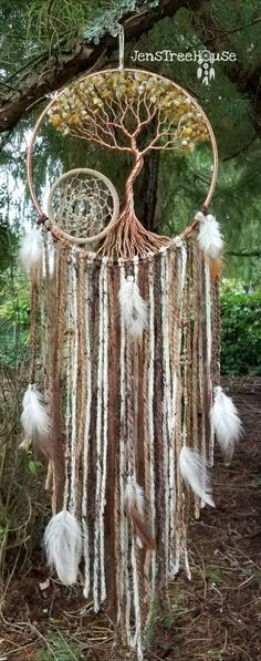 **8in Dream Catcher** copper wire honey opal chips diamond crystal Swarovski beads **3in Dream Catcher** beige suede lace hemp string topaz Czech beads crystal Swarovski bead center **Hanging Material** yarn (shades of brown) ribbon two strands of beaded hemp string including