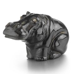 A FABERGÉ CARVED OBSIDIAN FIGURE OF A HIPPOPOTAMUS, ST. PETERSBURG, CIRCA 1900 depicted sitting, with diamond-set eyes with fitted holly wood box Length 1 7/8 in. 4.8 cm