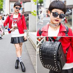 14-year-old Moeka (@kaemoooo) on the street in Harajuku wearing a red leather jacket from Hellcatpunks with a top, leather skirt, backpack, and ankle boots all from Glad News.