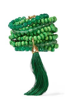 Rosantica's 'Etna' bracelet is strung with multiple strands of jade quartz and bright-green wooden beads. Handmade in Milan, it has a signature hammered gold-tone brass magnetic clasp fastening and removable tassel that elegantly drapes over your hand. Wear it solo with summer dresses or beach kaftans.