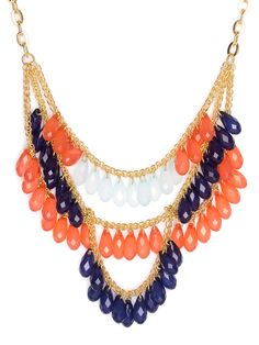 A rich cornucopia of peach and purple is punctuated by a slim row of alabaster jewels.  This unabashedly feminine take on the statement necklace boasts a fresh blend of punchy hues.