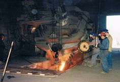 Tapping out steel from an electric arc furnace at the old Reliance Foundry plant