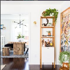 The Easy & Affordable Way To Give Your Space A Weekend Revamp #refinery29  http://www.refinery29.com/organized-decor-inspiration#slide-5  Build up! Adding a vertical, multi-functional stand like this to your home allows you to create mini vignettes while avoiding clutter. ...
