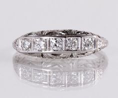 This lovely antique five diamond band is so stunning with fabulous quality European cut diamonds. This beauty can easily stand alone, worn on the wedding finger or on the right hand!   Antique 1910s 18K White Gold Diamond Wedding Band Arts and Crafts 18K White Gold 5 European Cut Diamonds =.30ct VVS2-VS1/G-I Ring Size 3-7/8 (ring is sizable) Ring measures approximately 5.8mm at center, band is 1.3mm    Please read our shop policies prior to purchase.