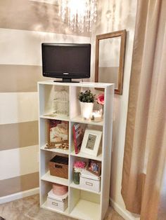 IKEA Storage turned into a beautiful storage/TV unit. Perfect idea to display your precious things as well as making a TV look a little more pretty in the bedroom.