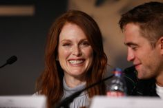 Julianne Moore and Robert Pattinson attend the 'Maps To The Stars' press conference during the 67th Annual Cannes Film Festival on May 19, 2...