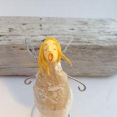 Tiny angel sculpture of handmade paper