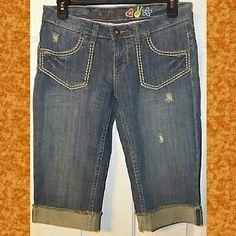 "Mudd Blue Jean Capri Shorts Size 5 Blue Jean Capri. Distressed. Brown tone. Cotton blend. Cuffed. 4 Pockets. Waist: 30"". Inseam: 15"". Rise:  7.5"". Mudd Shorts"