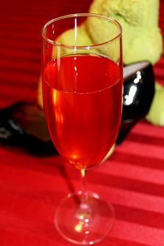 Polly Parrish 1/2 oz Amaretto  1/2 oz ginger syrup  1/4 oz grenadine  3-5 oz bubbly (depending on your glass)  Measure and pour the Amaretto, syrup, and grenadine into your flute or coupe. Gently add the champagne. Sip. Or down it.   Ginger Syrup (about 10 drinks)  1/2 c sugar  1/2 c water  10 thin slices of ginger root  Place ingredients in small saucepan and bring to boil. Stir to dissolve sugar. Remove from heat and let sit for about 30 minutes. Strain into a bottle or flask.