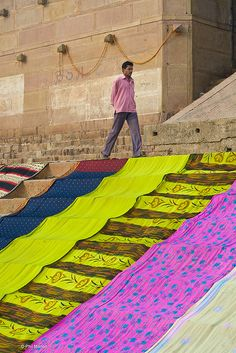 Colorful saris drying on the steps in Varanasi. #saree #varanasi @At Home In Bangalore