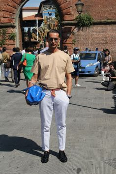 "Street Style Special Edition: The Men (and Women!) of Pitti Uomo by Mister Mort: ""His khaki woven shirt is worn like a tee and tucked into polka dot trousers with a necktie as a belt--just like Fred Astaire would do. His blue bag is a nice pop of color."""