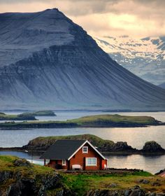 Iceland: cute & little red house set in front of majestic background.