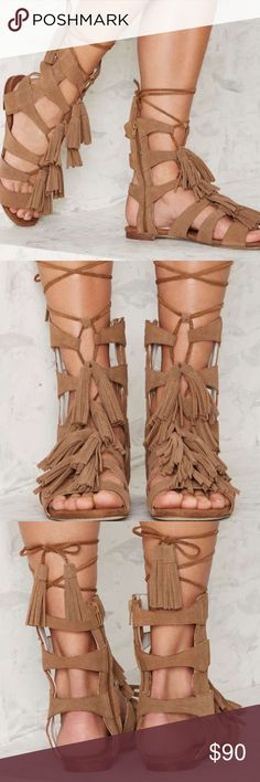Jeffrey Campbell Hang of Four Beige Suede Sandal The Hang of Four sandal by Jeffrey Campbell in beige suede leather features a cut-out gladiator design, wrap closure, side zip closure, and fringe tassel detailing. Size 6.5. Brand new in box. Jeffrey Campbell Shoes Sandals