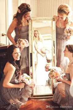 I like this picture idea. Catching the reflection of the bride on the mirror that the bridesmaids are holding.