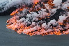 Lava flows out of the Bardarbunga volcano. At 6,500 feet, Bardarbunga is Iceland's second-highest peak and is located under one of Europe's largest glaciers, Vatnajoekull. #volcano #iceland #lava