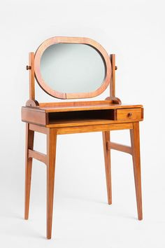 Mirror Mirror Vanity from Urban Outfitters: love the shape of the mirror!  Not sold on the wood colour and storage though