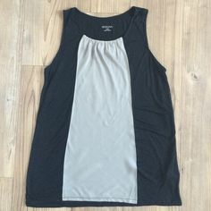 Black & Gray Sleeveless Top Black sleeveless top has a gray/silver middle with ruched neckline. Black part is 100% Polyester. Gray part is 100% Rayon. Merona Tops