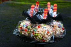 Homemade halloween treats- popcorn balls with trix cereal mixed in