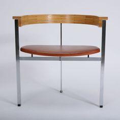 Poul Kjærholm   PK 11   Designed 1957     Width: 64 cm   Height: 65 cm   Depth: 46 cm     Materials: Steel and red leather   Manufacturer: E. Kold Christensen