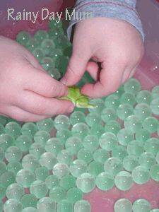 Water beads as frog eggs for sensory play. Now that is just brilliant.