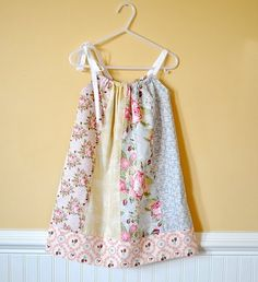 Amazing simple strip pieced sun dress but how pretty for a little girl.
