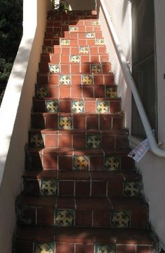spanish revival tile stairs from garage to kitchen Spanish Revival Home, Spanish House, Spanish Colonial, Tiled Staircase, Stairs, Stair Risers, Tile Steps, Spanish Villas, Revival Architecture