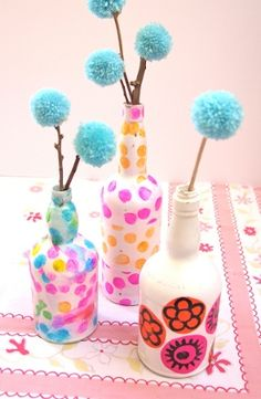 Turn old wine bottles into decorative vases using pretty patterned tissue paper. All you have to do to make this wine bottle craft is #decoupage