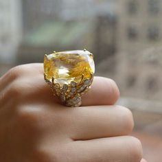 A 79.69 carat cushion-cut yellow #sapphire and #diamond ring by #DavidWebb. Available in our #NewYork Important Jewels sale #ChristiesJewels