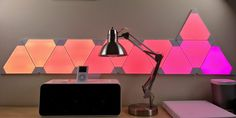 I've tried a few different HomeKit lighting solutions but nothing quite like Nanoleaf's Aurora smart lighting panels. These modular tiles probably won't replace traditional lamps or ceiling bulbs, … Unique Lighting, Home Lighting, Lighting Design, Nanoleaf Designs, Nanoleaf Aurora, Nanoleaf Lights, Smart Lights, Traditional Lamps, Wall Lights