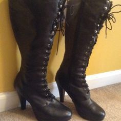 """Cute Black boots few scratches 4"""" heels sz.10 Looks great with skirts, legging, jeans,anything!! All man made material but looks like leather !! Those who have wide calves  adjustable straps to fit. Has some wear. See 2nd pic.. Please note there is a small hole in back of left boot Blossom collection Shoes"""