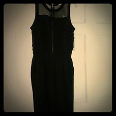 Forever 21 Black Dressy Jumper Black dressy jumper w/ zippered back Sheer a little in the front and back  Never worn Forever 21 Pants Jumpsuits & Rompers